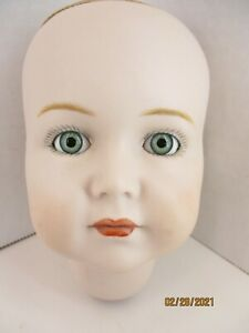 """Bisque Porcelain Doll Head with Brown Eyes 5"""" Tall Glass eyes Hand painted face."""