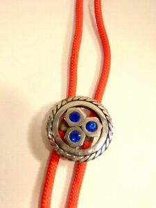 red bolo tie with round silver colored slide accented with blue crystals