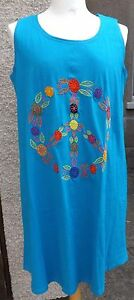 Peace dress , blue t-shirt dress with embroidered peace CND sign