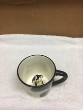 Cow Figurine In Coffee Cup