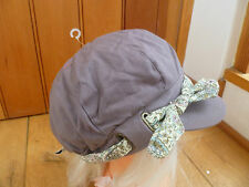 MONSOON ACCESSORIZE TAUPE BROWN FLOWER BAND EYELETS TIE PEAKED HAT CAP BAKER BOY
