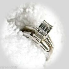 Diamond ring set with emerald cut solitaire