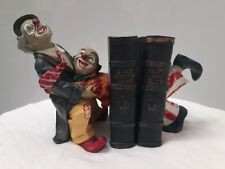Clown playing book ends