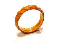 Bijou fantaisie bracelet jonc lucite torsadée jaune orangé bangle