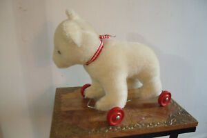 teddy herman original bear on red rollers pull toy