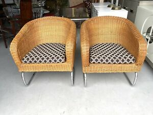 SPLENDID PAIR OF MID CENTURY HOLLYWOOD REGENCY WICKER AND CHROME LOUNGE CHAIRS