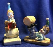 Pair of cute small clowns with barrels figurines