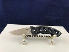 Blue Buck Plain Edge framelock pocket knife with silver belt clip 316