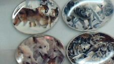 12 wolf collector plates 1 a month set with case. wlfpl