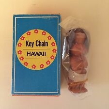 Vintage rubber doll Hawaii key chain tan hula girl grumpy baby face matchbox