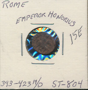 Roman Imperial Emperor being crowned by Victory reverse. 393-423 AD Bronze coin of Emperor Honorius