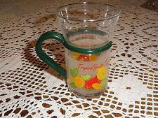 "grn plastic removable handle, bottom translucent w/""Tropical fruits Tea"" & fruit"