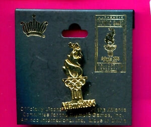 1996 OLYMPIC PIN GOLD OLYMPIC TORCH PIN ON A CARD