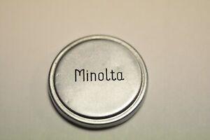 Original Minolta metal push on lens cap with ID of 36mm.