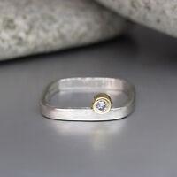 Ring mit ca. 0,05ct W-si Brillant in PT 950 Platin und 750/18K Gelbgold