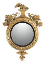 Regency Gilt Convex Mirror Eagle crest on pedestal flanked by applie. Lot 1242