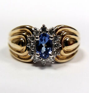 14ct Yellow Gold Ring with Oval Cut Sapphire and Diamonds