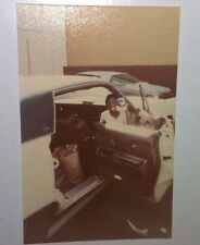 Vintage 70s Found PHOTO Younger Black Teen Boy In Classic Car Holding Up A Gift