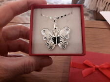 Brand new necklace with a white enamel butterfly on an 18in chain and gift box