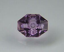 Amethyst. Custom Cut Modified Oval. Flat Facet With Carving. 3.53 cts.