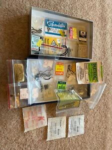 Assorted fly tying and fishing hooks