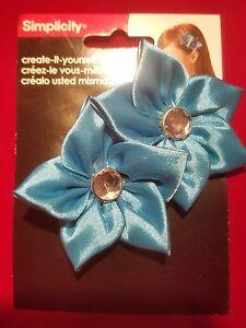 Simplicity light blue satin flowers/gem headband accent