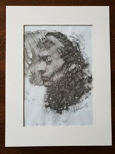 Ink portrait on graph paper, signed