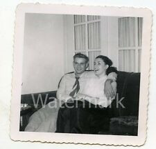 1950s vintage b/w snapshot  photo Man and lady on sofa  in living room