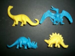 FOUR RARE PLASTIC AUSSIE MADE DINOSAURS BY TOLTOYS