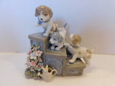 "Suberto Porcelain Three Puppies On Garden Steps, Dogs "" Puppy Love"" Music Box"