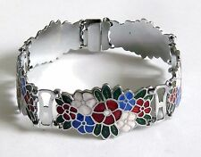 A VINTAGE 1930s SILVER TONE FLOWER BRACELET WITH RED, GREEN, BLUE & WHITE ENAMEL