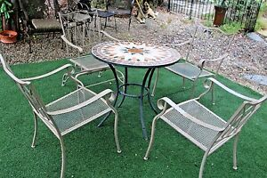 Five piece Iron Patio Set tiled Table top One rocker four chairs table