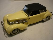 A Franklin mint scale model car of a 1937 CORD 812 Phaeton coupe