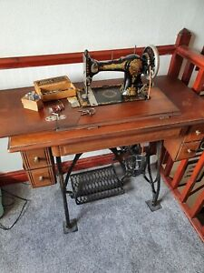 Jones Treadle Sewing Machine in table with drawers