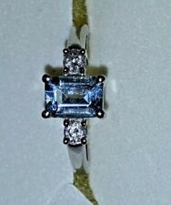14 KT White Gold Ring with Blue Topaz and diamonds