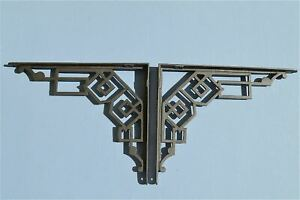 A PAIR OF STRIKING ART DECO CAST IRON SHELF BRACKETS SHELVING CISTERN BRACKET