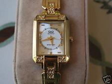 New Q&Q by Citizen Gold Tone Rectangular Lady Watch w/Diamond Bezel