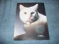 1992 Timex Wrist Watch Vintage Ad with a Cat with Yellow and Blue Eyes
