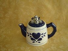 Blue and White Teapot with 3D Tea Set on Top of Lid