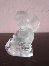 Clear glass angel with sled figurine for sale by owner!!!