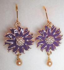 Purple flower enamel effect drop earrings in gold tone with faux pearl drop. 5cm