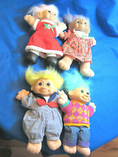 FOUR (4) LARGE TROLL DOLLS WITH CLOTHES.