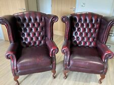More details for a matching pair of leather chesterfield chairs