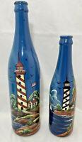 "2 Decorative Lighthouse Sailboat Cottage Seascape Painted Bottles 11.5""H & 9""H"