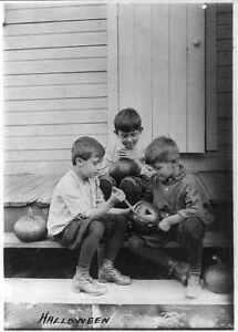 Photo:Halloween,3 boys on porch steps carving pumpkins,c1917 7727