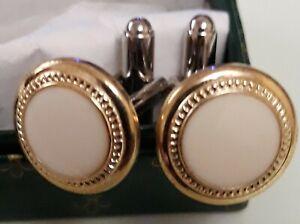 Designer cufflinks: White with gold surround