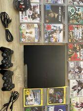 PlayStation 3 Slim mit 18 Spielen