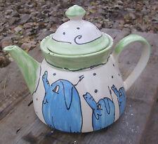 Teekannen mit Bildmotiven