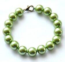 Modeschmuck-Armbänder aus Glas und Edelstahl mit Perle