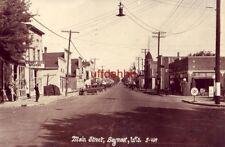 RPPC MAIN STREET SEYMOUR, WI 1942 Jack & Andy Nienhaus Auto Repair, Harness Shop